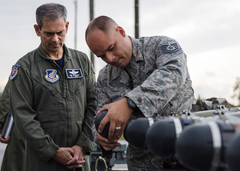 U.S. Air Force Tech Sgt. Humberto Laviera, right, 51st Munitions Squadron conventional maintenance production superintendent, shows Lt. Gen. Kenneth Wilsbach, Seventh Air Force commander, the inside of a munition at Osan Air Base, Republic of Korea, Oct. 26, 2018.  As the new 7th AF commander, Wilsbach toured various units around Osan Air Base to include the 51st MUNS, 51st Aircraft Maintenance Squadron, and the 25th and 36th Fighter Squadrons.  (U.S. Air Force photo by Staff Sgt. Rachel Maxwell)