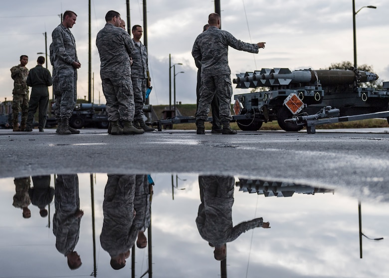 Personnel assigned to the 51st Munitions Squadron briefs Lt. Gen. Kenneth Wilsbach, Seventh Air Force commander, on the various munitions assigned to the unit during an immersion tour at Osan Air Base, Republic of Korea, Oct. 26, 2018.  As the new 7th AF commander, Wilsbach toured various units around Osan Air Base to include 51st MUNS.  (U.S. Air Force photo by Staff Sgt. Rachel Maxwell)