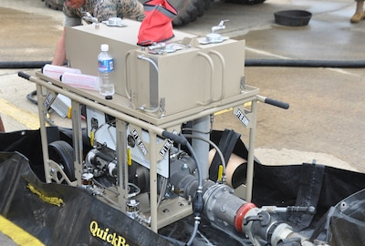 The Marine Corps Expeditionary Mobile Fuel Additization Capability prototype system is the Hammonds Model TPI-3T-3A Portable Fluid Powered Additive Injector. It is a small, easy to use, two-man carry system.