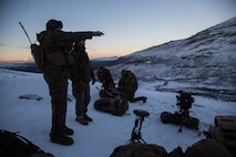 U.S. Marines with Marine Rotational Force-Europe 19.1 and Norwegian Army soldiers prepare for close-air support drills in Setermoen, Norway, Oct. 25, 2018.
