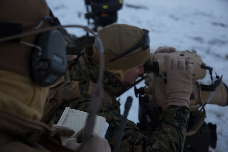 A U.S. Marine with Marine Rotational Force-Europe 19.1 reads information off from an AN/PAS-25 portable lightweight designator rangefinder during close air support in Setermoen, Norway, Oct. 25, 2018.