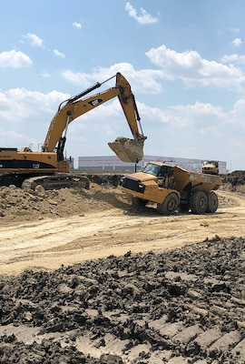 Workers excavate a site at Urban Mining Company's facility for manufacturing neodymium/iron/boron magnets in San Marcos, Texas.