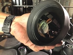 Eric Deal of DLA Strategic Materials checks out a lens from Anniston Army Depot, Alabama. Germanium will be extracted from the lens and stockpiled until needed.