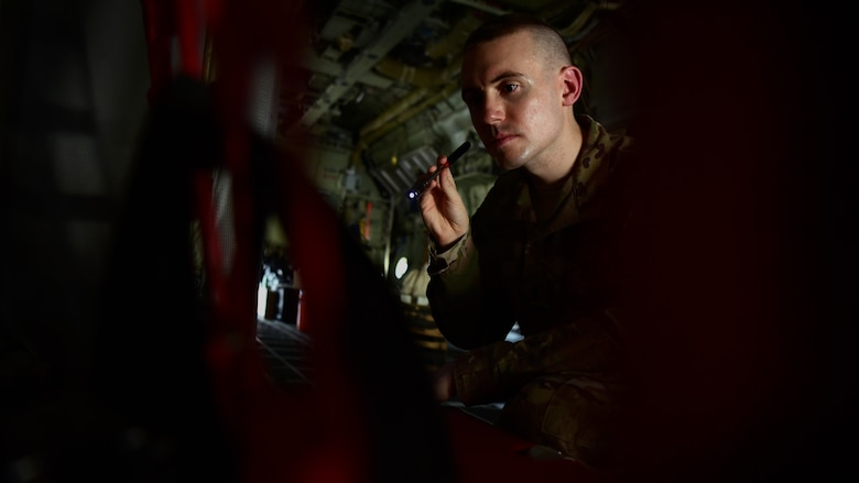U.S. Air Force 1st. Lt. Collin Dart, 386th Expeditionary Maintenance Group depot liaison engineer, inspects the internals of a C-130 Hercules aircraft Oct. 17, 2018, at an undisclosed location in Southwest Asia. As a member of the Joint Combat Assessment Team, Dart evaluates aviation combat damage incidents, assesses the threat environment for operational commanders, and collects data to support aircraft survivability research and development. (U.S. Air Force photo by Staff Sgt. Christopher Stoltz)