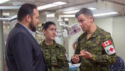 Tyler Wordsworth, senior trade commissioner, Embassy of Canada, talks with Canadian military members.