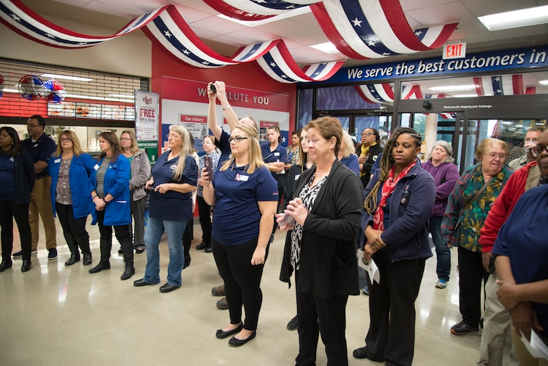 Army & Air Force Exchange Service employees and customers watch during the Wright-Patterson Exchange's grand re-opening ceremony Oct. 25, 2018.