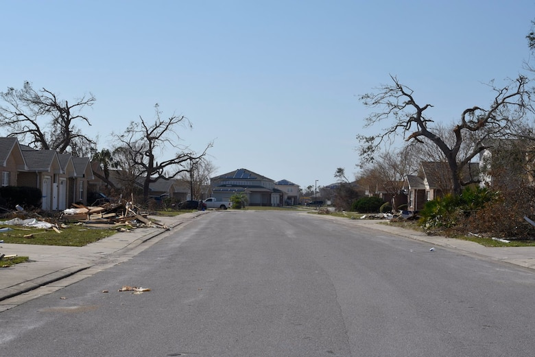 A residential street in base housing is stricken with damage Oct. 18, 2018 at Tyndall Air Force Base, Fla. In the aftermath of Hurricane Michael, the Krietes relied on the Air Force and each other to overcome adversity. (U.S. Air Force photo by Airman 1st Class Dalton Williams)