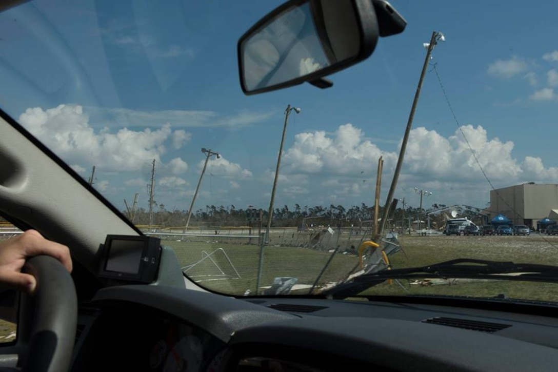 1st Lt. Adam Kriete, 337th Air Control Squadron student, drives pas a damaged baseball field Oct. 19, 2018, at Tyndall Air Force Base, Fla. In the aftermath of Hurricane Michael, the Krietes relied on the Air Force and each other to overcome adversity. (U.S. Air Force photo by Airman 1st Class Dalton Williams)