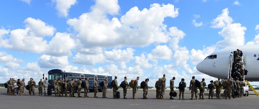 Deploying service members board an aircraft in preparation to deploy through Joint Base Charleston Oct. 15, 2018 in support of the Naval Station Norfolk air terminal while their airfield under goes scheduled maintenance.