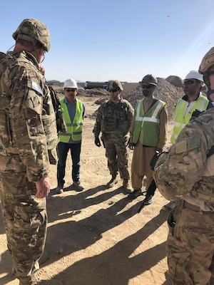 USACE Afghanistan personnel and the Contractor discuss the Well Site project schedule.