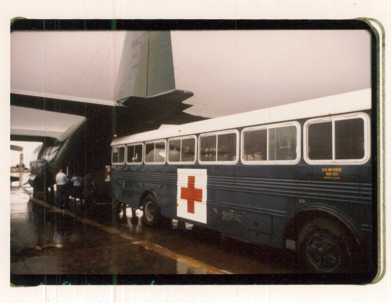 A hospital bus backs up to a C-130 Hercules aircraft to transport victims of the Pines Hotel fire to the regional medical center, Clark Air Base, Philippines, Oct. 23, 1984. (Courtesy photo)