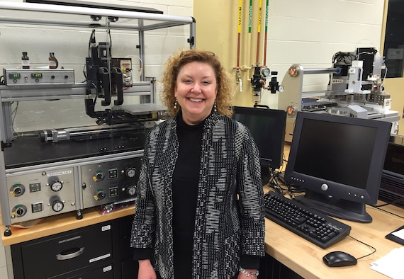 Dr. Katie Thorp, then chief of the Soft Matter Materials Branch, Materials and Manufacturing Directorate, Air Force Research Laboratory, stands in front of a printer that can use conductive, multi-purpose inks in this photo taken in March 2015. Thorp had fought cancer since 1994 and had trained as a resilience training assistant to pass along knowledge she had gained in her own personal battle with cancer. Thorp passed away in July 2018, just one day after learning about winning the Society of Women Engineers PRISM Award. (Skywrighter photo/Amy Rollins)