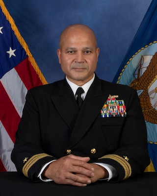 Commander Carlos J. Cintron is originally from Buffalo, NY. He earned a B.S. in Chemistry at Rochester Institute of Technology in 1993 and was subsequently commissioned through the ROTC program at the University of Rochester.