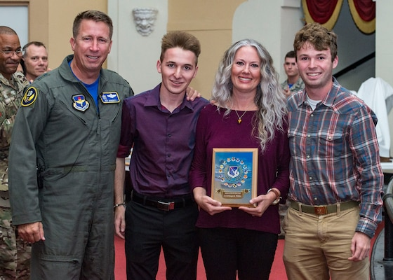 Maj. Gen. Patrick Doherty, 19th Air Force commander, posthumously presents the C-130H High Flyer Award to the wife and sons of Lt. Col. Reagan K. Whitlow, Deeanne, Koby and Kale Whitlow during the Air Education and Training Command Flying Training Awards Ceremony Oct. 26, 2018, at Joint Base San Antonio-Randolph, Texas. The award ceremony recognizes individuals, squadrons, groups and wings whose efforts have led to the highest levels of student production.