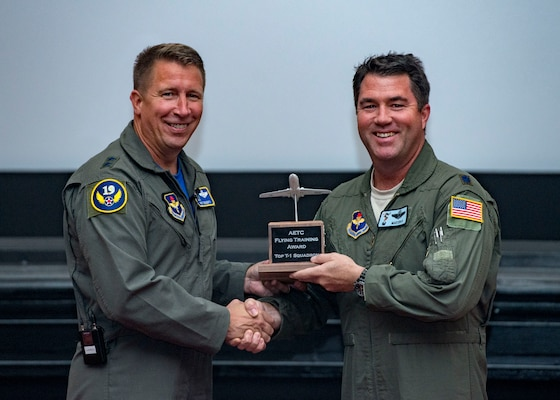 Maj. Gen. Patrick Doherty, 19th Air Force commander, presents the Top T-1 Squadron Award to Lt. Col. John Masterson, 3rd Flying Training Squadron commander, during the Air Education and Training Command Flying Training Awards Ceremony Oct. 26, 2018, at Joint Base San Antonio-Randolph, Texas. The award ceremony recognizes individuals, squadrons, groups and wings whose efforts have led to the highest levels of student production.