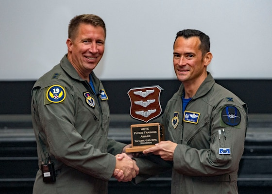 Maj. Gen. Patrick Doherty, 19th Air Force commander, presents the Top Combat Systems Operator/Remotely Piloted Aircraft/Air Battle Manager Squadron Award to the 337th air Control Squadron, during the Air Education and Training Command Flying Training Awards Ceremony Oct. 26, 2018, at Joint Base San Antonio-Randolph, Texas. The award ceremony recognizes individuals, squadrons, groups and wings whose efforts have led to the highest levels of student production.