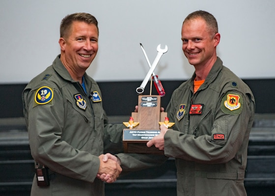 Maj. Gen. Patrick Doherty, 19th Air Force commander, presents the Top Maintenance Organization-Gray Jet Division Award to Lt. Col. Michael Lambert, 173rd Maintenance Group commander, during the Air Education and Training Command Flying Training Awards Ceremony Oct. 26, 2018, at Joint Base San Antonio-Randolph, Texas. The award ceremony recognizes individuals, squadrons, groups and wings whose efforts have led to the highest levels of student production.