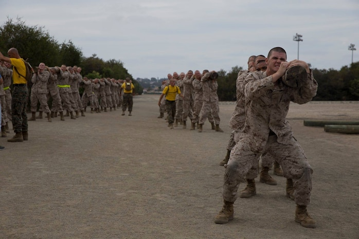 Recruits with Echo Company, 2nd Recruit Training Battalion, Recruit Training Regiment, carry a log during Log Drills at Marine Corps Recruit Depot San Diego, Oct. 22.