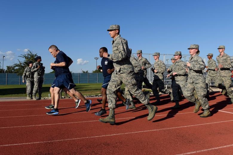 Airmen from the 315th Training Squadron run during the 24-hour Prisoners of War and Missing in Action Vigil at the track on Goodfellow Air Force Base, Texas, Oct. 26, 2018. Individuals carried the baton for 24 hours, passing it to others while running to ensure that it didn't stop moving. (U.S. Air Force photo by Senior Airman Randall Moose/Released)