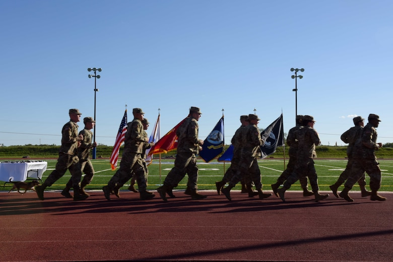 Soldiers from Goodfellow Air Force Base run during the 24-hour Prisoners of War and Missing in Action Vigil at the track on Goodfellow AFB, Texas, Oct. 27, 2018. Members from the base and San Angelo participated in the run to honor past and present prisoners of war and military members missing in action. (U.S. Air Force photo by Senior Airman Randall Moose/Released)