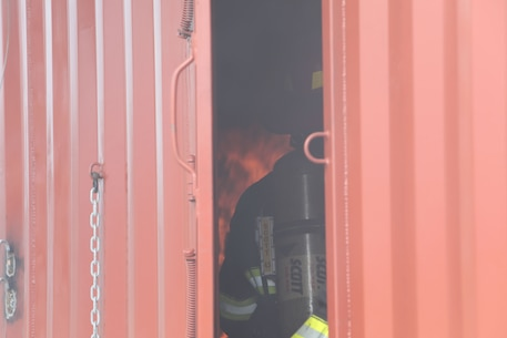 Dozens of firefighters aboard Marine Corps Logistics Base Albany got a chance to build some critical skills thanks to a new live fire structural trainer, October 25. The installation recently purchased the structural trainer; the original cement structure was condemned 10 years ago. (U.S. Marine Corps photo by Re-Essa Buckels)