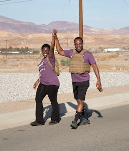 Maj. Ernest Robinson, MCLB Barstow base operations, and wife, Gwendolyn, prove they are champs taking part in the 2018 Survivor Walk aboard base Oct. 26. The Survivor Walk is held annually aboard Base to bring awareness to Domestic Violence Prevention.