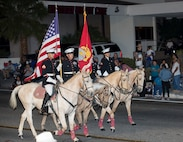 The Marine Corps Mounted Color Guard presents the colors while taking the lead of the 86th annual Kiwanis Club Mardi Gras Parade, Oct. 27. The parade was originally on Halloween but was changed to the weekend prior to allow the children to go trick or treating.