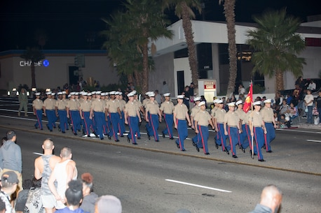 Marines of Headquarters Company, Marine Corps Logistics Base Barstow, strut their stuff during the 86 annual Kiwanis Club Mardi Gras Parade, in Barstow, Calif. Oct 27. The parade was originally held on Halloween but was changed to the weekend prior to allow the children to go trick or treating.