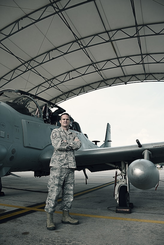 Senior Master Sgt. Scott Lopez, the maintenance superintendent for the 476th Maintenance Squadron at Moody Air Force Base, Ga., and Tech. Sgt. Lauren Camarena, an electrical and environmental systems craftsman with the 476 MXS, pose with an A-29 Super Tucano October 25, 2018, at Moody AFB.