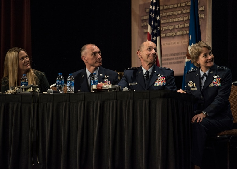 Mandy Vaughn, President of VOX space, Chief Master Sgt. Larry Williams, Air Mobility Command commander, Gen. Mike Holmes, Air Combat Command commander, and Gen. Maryanne Miller, AMC commander listen to a presentation from one of AMC�s innovators during the 2018 AMC Phoenix Spark Tank competition, Grapevine, Texas, Oct. 27, 2018. The winner, Staff Sgt. Travis Alton from the 19th Logistics Readiness Squadron, won at the command level and will advance to the Air Force-level competition. A/TA, AMC's premier professional development event, provides mobility Airmen an opportunity to learn about and discuss mobility priorities, issues, challenges, and successes. The venue creates dialogue between industry experts and Air Force and Department of Defense about ways to innovate, enhance mission effects and advance readiness headed into the future.   (U.S. Air Force photo by Tech. Sgt. Jodi Martinez)