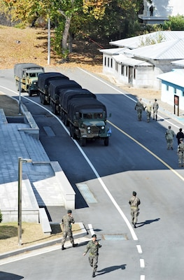 A convoy prepares to depart the Joint Security Area (JSA) during demilitarization efforts as part of the Comprehensive Military Agreement between the Republic of Korea (ROK) and the Democratic People's Republic of Korea (DPRK) at the JSA, Panmunjom, ROK, Oct. 25, 2018. In coordination with the Ministry of National Defense, the United Nations Command verified ROK and DPRK demilitarization efforts which included removal of weapons from guard posts and reducing security personnel at the JSA.