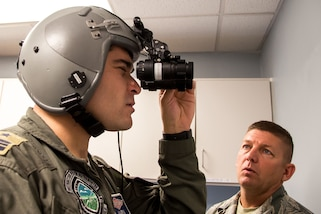 Chilean Air Force Maj. F. Marin, a C-130 pilot with the N10 Squadron, lines up the lenses on night vision goggles July 24, 2018, at Naval Air Station Fort Worth Joint Reserve Base, Texas. Marin visited the wing as part of the State Partnership Program, which forges mutually beneficial partnerships with some of the 136th Airlift Wing's staunchest allies and partners worldwide.