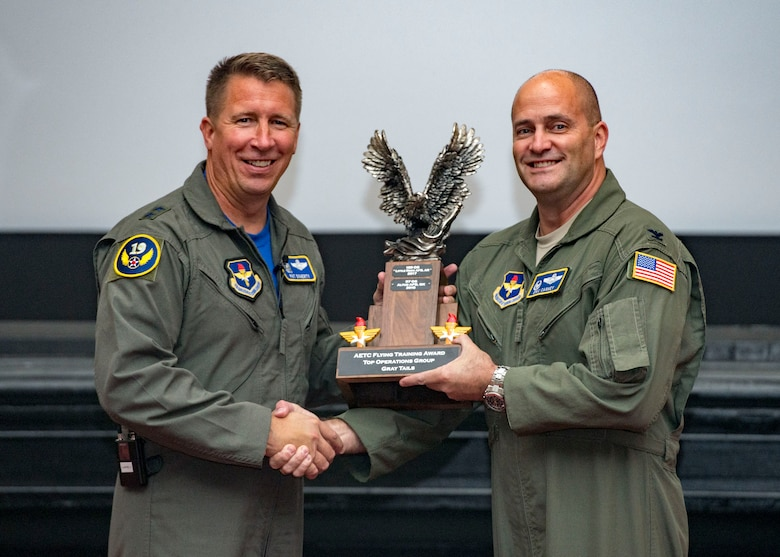 Maj. Gen. Patrick Doherty, 19th Air Force commander, presents the Top Operations Group-Gray Tail Division Award to the 97th Operations Group during the Air Education and Training Command Flying Training Awards Ceremony Oct. 26, 2018, at Joint Base San Antonio-Randolph, Texas. The award ceremony recognizes individuals, squadrons, groups and wings whose efforts have led to the highest levels of student production.