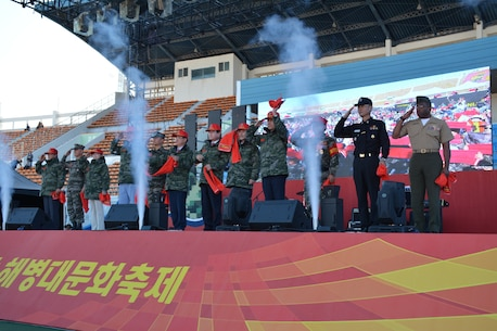 Republic of Korea (ROK) and U.S. Marines and civilian DVs salute during the 2018 Pohang Marine Corps Cultural Festival in Pohang, Republic of Korea, Oct. 20, 2018. The festival was held to display the capabilities of the ROK Marine Corps and celebrate the ROKMC. U.S. Marines from Camp Mujuk marched with the ROK Marines during the festival in order to display their partnership. (U.S. Marine Corps photo by Kyongcha Ha)
