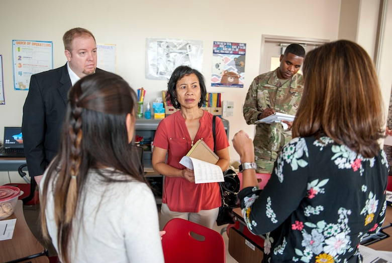 Sharene Brown, spouse of U.S. Air Force Gen. CQ Brown, Jr., Pacific Air Forces (PACAF) commander, greets Team Kadena spouses during the PACAF commander's visit at Kadena Air Base, Japan, Oct. 22, 2018. PACAF spouses and Team Kadena spouses talked about the challenges faced by military families on Okinawa. (U.S. Air Force photo by Naoto Anazawa)