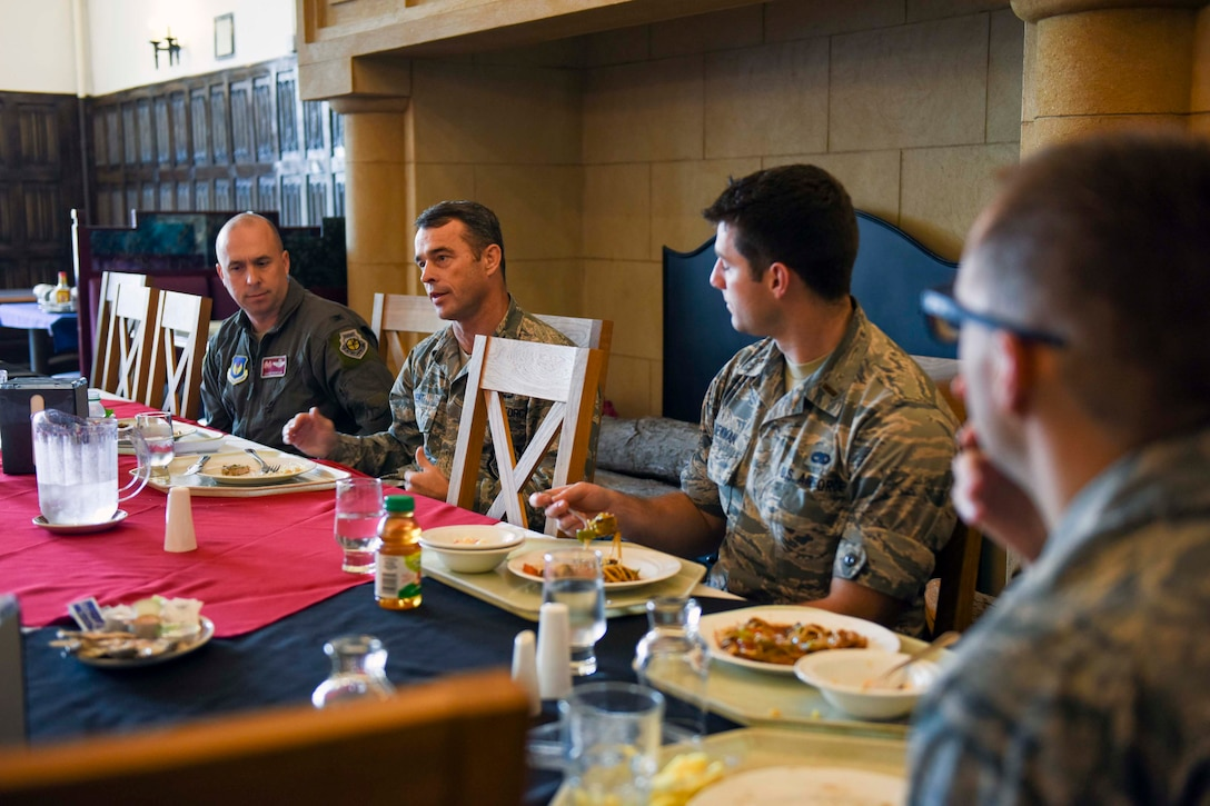 U.S. Air Force Col. John Kent, 48th Fighter Wing vice commander, speaks with flight commanders during a joint base flight commanders' course lunch at RAF Mildenhall, England, Oct. 26, 2018. Both vice commanders from the 48th FW and 100th Air Refueling Wing answered questions from  flight or squadron commanders had. (U.S. Air Force photo by Staff Sgt. Christine Groening)