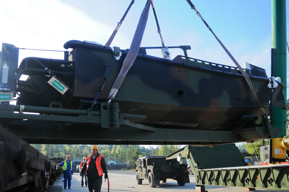 KAISERSLAUTERN, Germany – Civilian contractors, guide a bridge erection boat to be loaded onto the railhead, at Kaiserslautern Army Depot, April 18. (U.S. Army photo by Spc. Dashaad Boyd, 21st TSC Public Affairs)