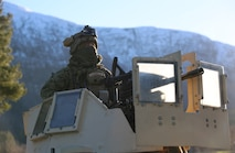 A U.S. Marine with 24th Marine Expeditionary Unit await commands atop a High Mobility Multipurpose Wheeled Vehicle during Exercise Trident Juncture 18 in Alvund, Norway, Oct. 29, 2018.