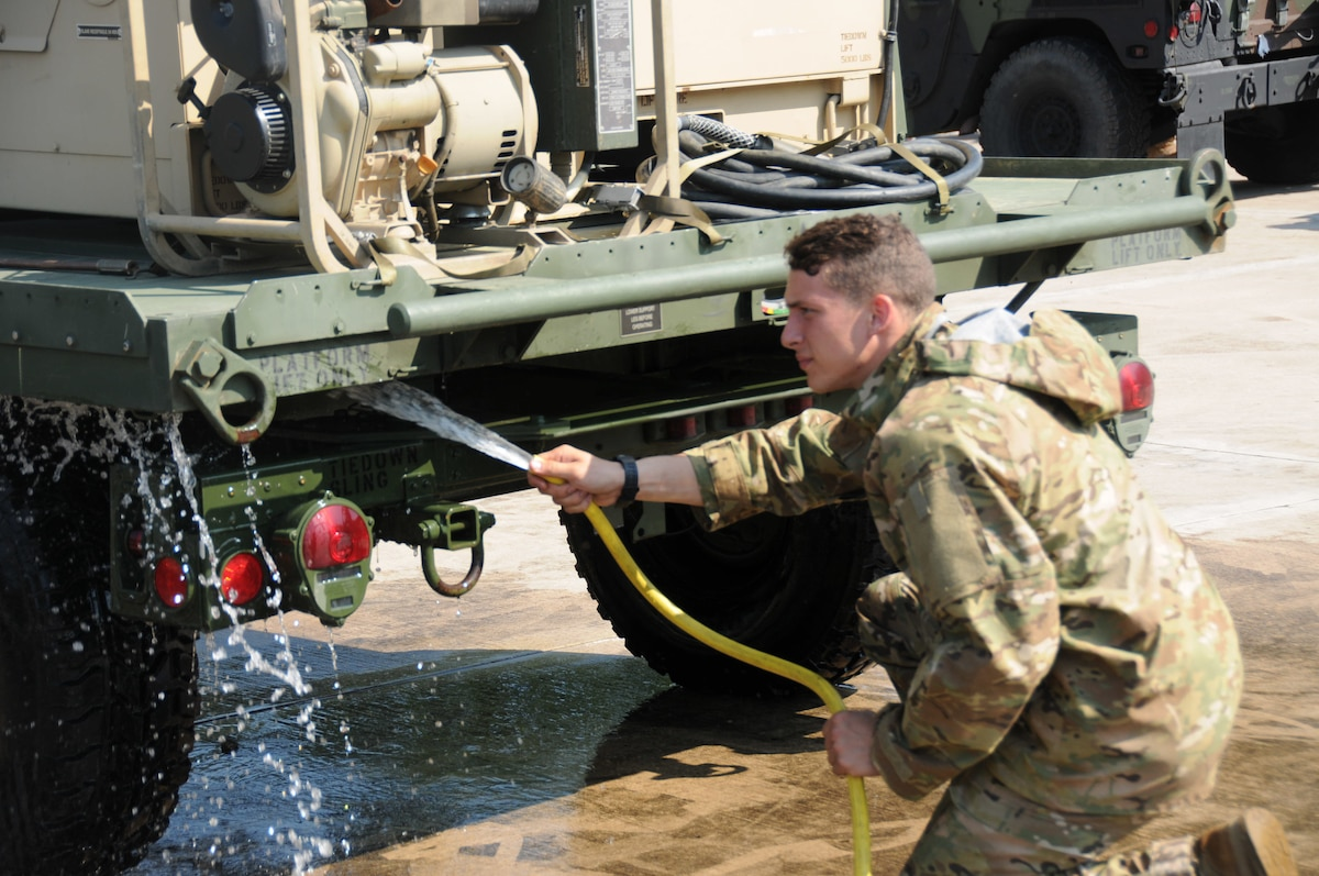 Soldier from 173rd Airborne Brigade utilize the Theater Logistic Support Center-Europe's Deployment Processing Centers wash rack on Rhine Ordnance Barracks, June 5.