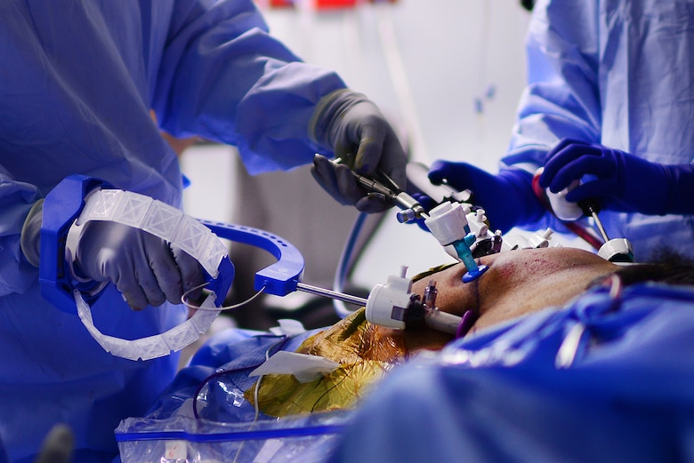 U.S. Air Force Major Richard Knight, Diplomate of the American Board of Urology, Chief of Surgery at the 48th Medical Group, uses FlexDex surgical technology to suture during a laparoscopic radical prostatectomy surgery at Royal Air Force Lakenheath, England Oct. 18, 2018. The FlexDex surgical platform precisely transforms the surgeon's hand, wrist, and arm movements outside the patient into conforming actions of an end-effector inside the patient's body. (U.S. Air Force photo/ Tech. Matthew Plew)