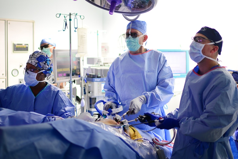 U.S. Air Force Major Richard Knight (center), Diplomate of the American Board of Urology, Chief of Surgery at the 48th Medical Group, performs a laparoscopic radical prostatectomy surgery using FlexDex technology at Royal Air Force Lakenheath, England Oct. 18, 2018. A single instrument averages around $500, a fraction of the cost of robotic surgical systems which average at $2-million dollars. (U.S. Air Force photo/ Tech. Matthew Plew)