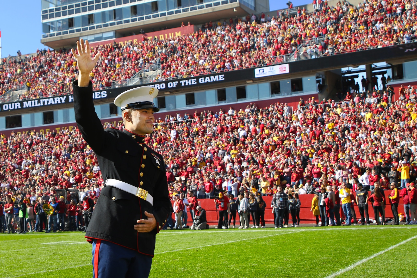 """Chicago, Ill. native, Sgt. Nicholas Rojas, administrative specialist with Marine Corps Recruiting Station Des Moines, Iowa, is recognized as the """"Hero of the Game"""" during the Iowa State University versus Texas Tech University football game at Jack Trice Stadium in Ames, Iowa, October 27, 2018."""
