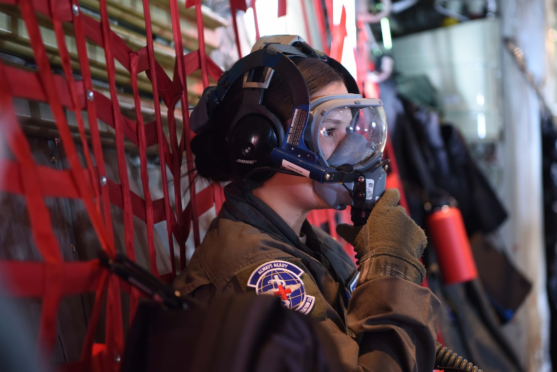 U.S. Air Force Tech. Sgt. Christine Williams, 86th Aeromedical Evacuation Squadron aeromedical  evacuation technician, secures her oxygen mask during an emergency procedures drill on a C-130J Super Hercules aircraft, Oct. 23, 2018. During the training mission, the aeromedical evacuation technicians practiced emergency procedures for fires and depressurization.