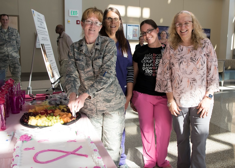 (From left to right) Lt. Col. Debra Smith, 49th Medical Group women's health element chief; Deborah Dolly, 49 MDG disease manager; Felicia Moore, 49 MDG disease manager; and Juli Bailey, 49 MDG health promotion coordinator, pose for a photo during the 49 MDG Breast Cancer Awareness Month Celebration October 25, 2018, at Holloman Air Force Base, N.M. October is Breast Cancer Awareness Month, and is dedicated to educating the public about breast cancer, how to prevent it and what treatments are available. (U.S. Air Force photo by Staff Sgt. BreeAnn Sachs)