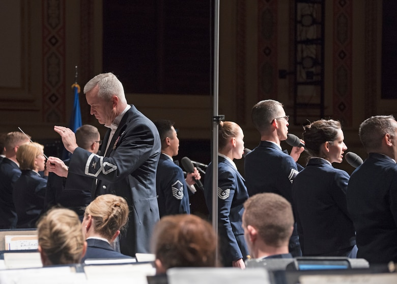 Col. Larry H. Lang, U.S. Air Force Band commander and conductor, leads the band and Singing Sergeants during a performance at the San Angelo Performing Arts Center in San Angelo, Texas, Oct. 22, 2018. The band performed in 12 locations across New Mexico and Texas. (U.S. Air Force photo by Senior Airman Abby L. Richardson)
