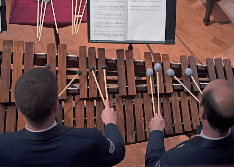 Tech. Sgt. Matt Penland, left, and Master Sgt. Marc Dinitz, right, U.S. Air Force Band percussionists, play the marimba during a performance at the University of North Texas in Denton, Texas, Oct. 25, 2018. The band performed in locations across New Mexico and Texas to inspire and engage the local communities. (U.S. Air Force photo by Senior Airman Abby L. Richardson)
