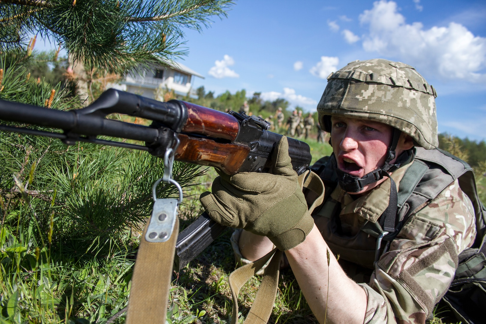Mentored by Army's 45th Infantry Brigade Combat Team, Ukrainian soldier calls out to fellow soldier during training at Yavoriv Combat Training Center, International Peacekeeping and Security Center, near Yavoriv, Ukraine, May 15, 2017 (U.S. Army/Anthony Jones)