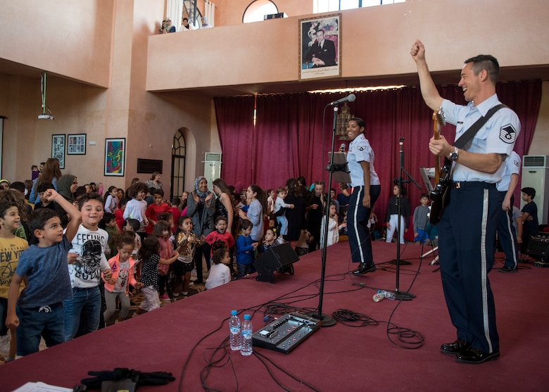 MARRAKECH, Morocco (Oct 23, 2018) Master Sergeant Johnny Kukan, USAFE-AFAFRICA Band Touch n' Go NCOIC/guitarist, performs at The American School of Marrakesh. The band, in Morocco to support the African Air Chiefs Symposium and the Marrakech Air Show, also had the opportunity to perform for nearly 400 students. The aviation events and band performances highlighted the strong cooperation and partnership between the U.S. and Morocco and demonstrates U.S. commitment to safety and security across Africa.  (DoD photo by Mass Communication Specialist 2nd Class Cody Hendrix)