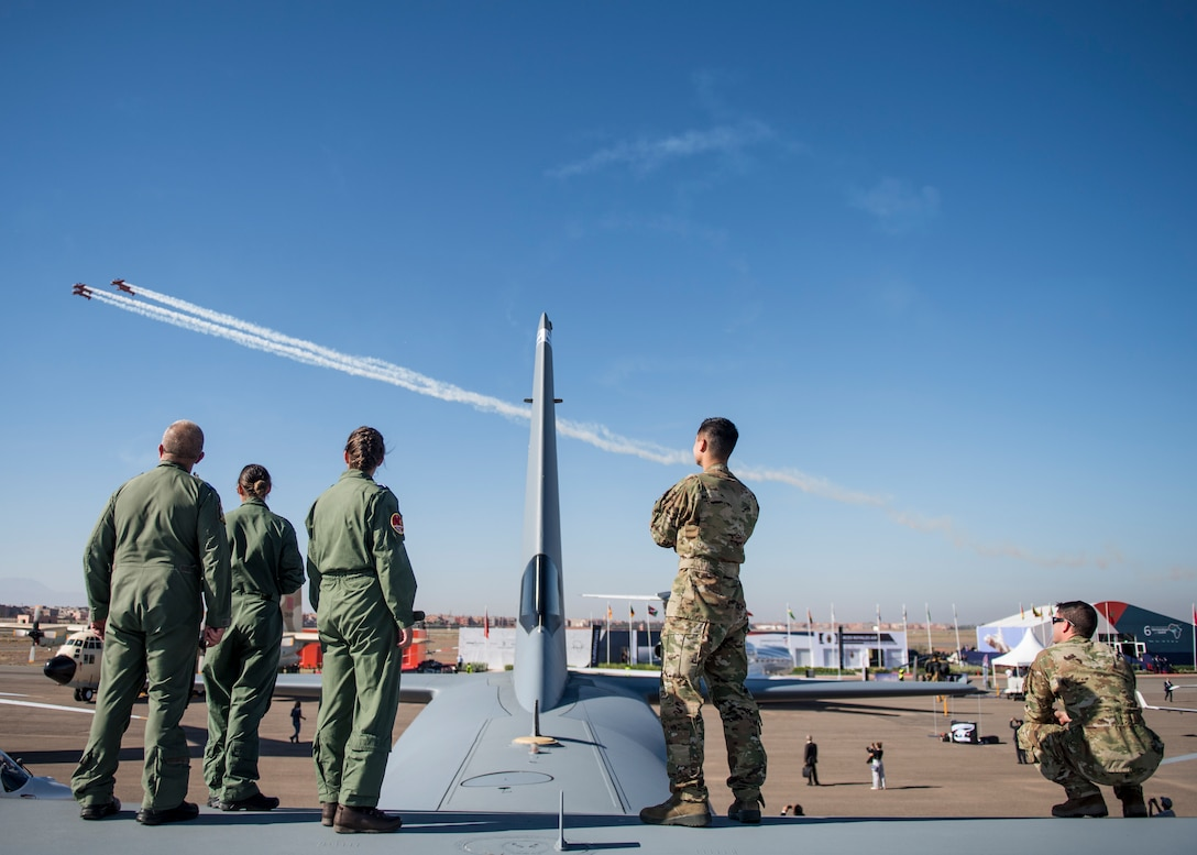 MARRAKECH, Morocco (Oct 24, 2018) U.S. Air Force and British Royal Air Force Airmen spectate the 2018 Marrakech Air Show while on top of a C-130 Hercules. The air show provides a unique opportunity for the U.S. along with other military partners to showcase leadership in aerospace technologies while supporting various armament procurement competitions taking place throughout Europe and Africa. (DoD photo by Mass Communication Specialist 2nd Class Cody Hendrix)