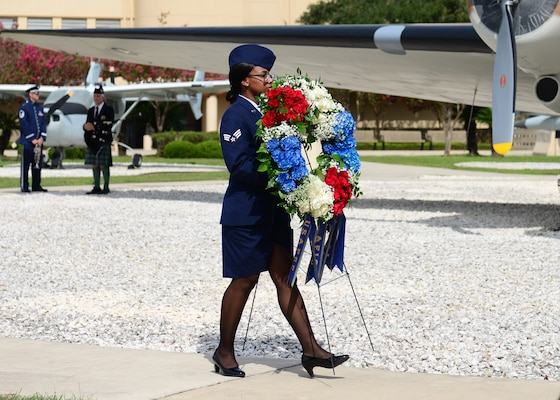 Airman 1st Class Janaya Fulton, 625th Operations Center, carries a memorial wreath during the Twenty-Fifth Air Force Remembrance Ceremony at Joint Base San Antonio-Lackland Sept. 28. The ceremony is held every year to honor the fallen silent warriors from the previous 12 months.